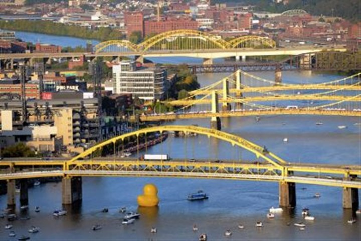 Pittsburgh Cultural Trust's Pittsburgh International Festival of Firsts The 40-foot inflatable rubber duck is towed down the Allegheny River going under the Fort Duquesne Bridge on its way to its temporary home near the Roberto Clemente Bridge. The duck's arrival marks the start of Pittsburgh Cultural Trust's Pittsburgh International Festival of Firsts.