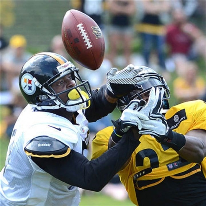 plax and malone Plaxico Burress is defended by corner Nigel Malone during a recent Steelers practice at Saint Vincent College in Latrobe.