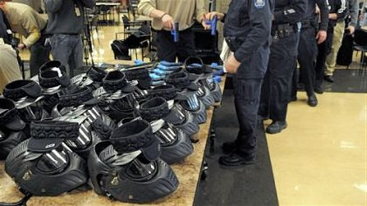"Police 1 Officers get their ""sim-guns"" and helmets in the South Fayette cafeteria."