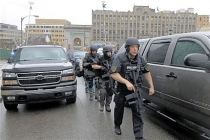police Western Psych shooting Police officers dressed in swat gear make their way up De Soto Street towards Western Psychiatric hospital on March 8, 2012.