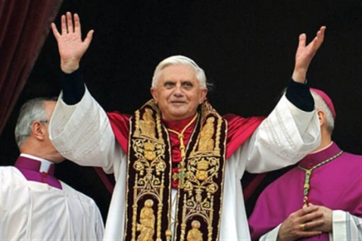 Pope waves Pope Benedict XVI greeting the crowd from the central balcony of St. Peter's Basilica moments after being elected in 2005.
