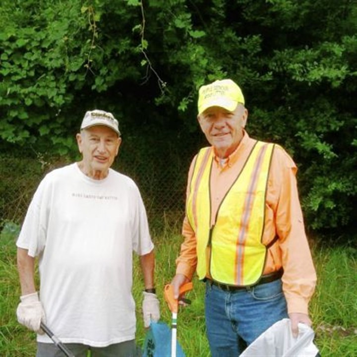 portfolio Boris Weinstein, left, and Gary Smith, formerly of Pittsburgh, clean up in North Point Breeze.