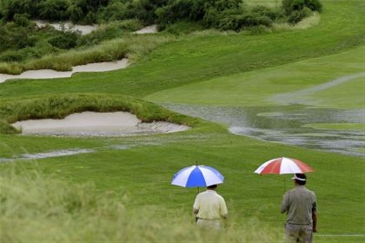 psu2 It's always sunny in philadelphia ... Golf fans walk along the 16th fairway Monday as rain falls at Merion Golf Club, in Ardmore, Pa. The prospect of a firm, fast course for the 113th U.S. Open diminished with every raindrop Monday at Merion, outside of Philadelphia, where practice rounds twice were suspended due to heavy rain.