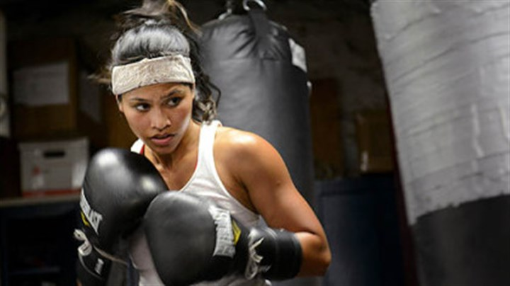 Punching bag Jennifer Dugwen Chieng hits a punching bag as a part of her daily training routine Tuesday at the Third Avenue Boxing Gym in Downtown Pittsburgh.