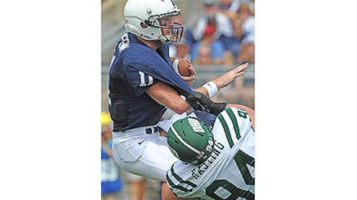 QB sack Penn State quarterback Matt McGloin is sacked by Ohio University's Corey Hasting in the first half of today's game at State College.