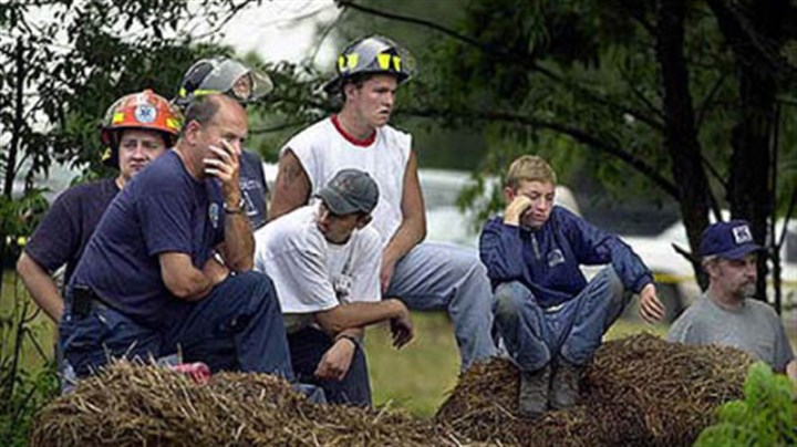 quecreek scene file photo July 27, 2002: Emergency workers and other residents of the Quecreek area waited as drilling rigs raced to get trapped miners out of the flooded Quecreek Mine.