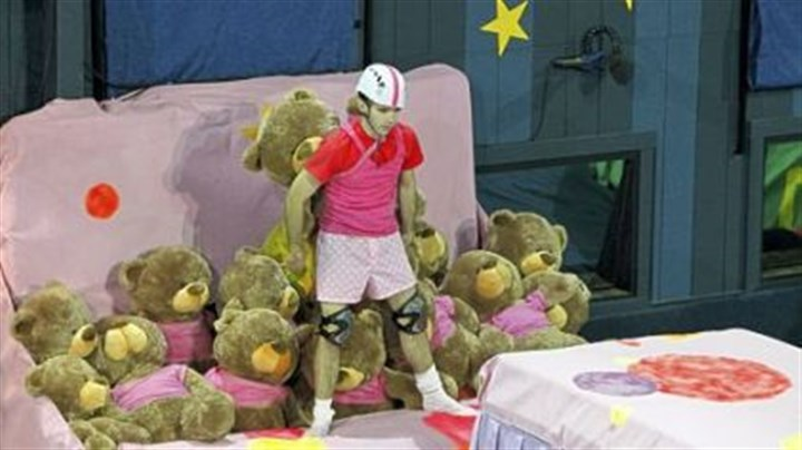 "Reality Check ""Big Brother"" contestant Ian Terry, a Shaler Area High School grad, tries to transport a teddy bear across an obstacle course in a household competition."