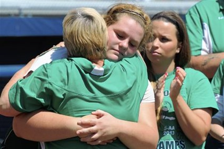 Riverside softball Riverside starting pitcher Kirsten Wilson is comforted by coach Pam McCarty after the team lost to Brandywine Heights, 1-0, in the PIAA Class AA softball championship game last Friday in University Park, Pa.