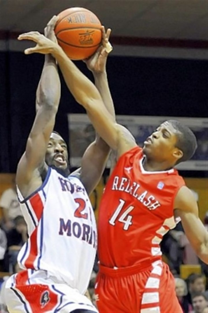 rmu1 Robert Morris' Lucky Jones takes a foul from Saint Francis' Dom Major in the first half at the Sewall Center Wednesday night.