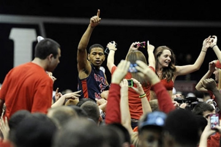 RMU2 Robert Morris guard Karvel Anderson (15) celebrates with fans following the huge 59-57 win against Kentucky.