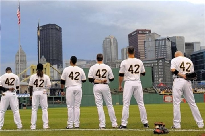 robinson Pirates players stand as the national anthem is played Monday at PNC Park. All players wore No. 42 in honor of Jackie Robinson.