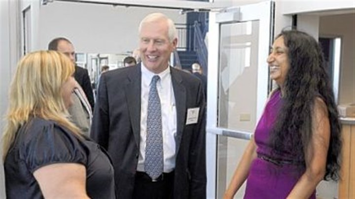 Rodney Erickson Penn State President Rodney Erickson talks with Lori Johnson, left, and professor Kausalai Wijekumar, right, after the dedication of the new wellness center at Penn State Beaver.