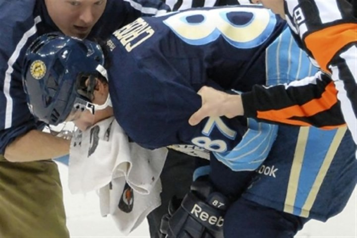 Ron Cook Sidney Crosby is helped from the ice March 30 by head athletic trainer Chris Stewart.