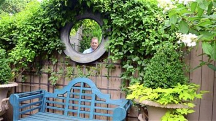 Ron Kotcho Ron Kotcho is reflected in a mirror in the garden he designed in Squirrel Hill. The garden has been accepted into the Smithsonian's Archive of American Gardens.