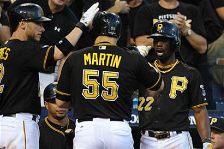 Russell Martin Pirates Andrew McCutchen celebrates with Russell Martin after scoring on a sacrifice fly by Martin in the sixth inning.