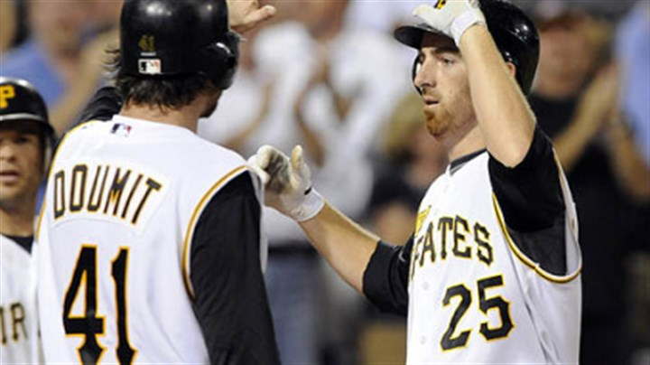 Ryan Doumit Ryan Doumit greets Adam LaRoche after hitting a grand slam off Dodgers starting pitcher Chad Billingsley in the fifth inning last night at PNC Park.