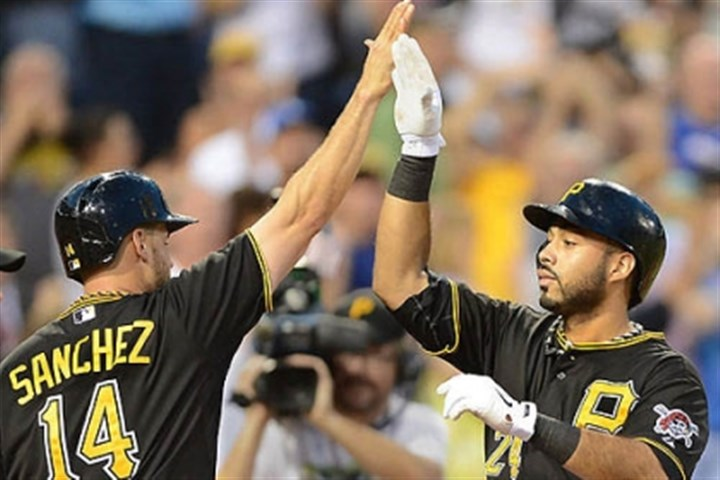 sanchez and alvarez Pirates third baseman Pedro Alvarez is greeted at home after hitting a three-run homer in the bottom of the fifth.