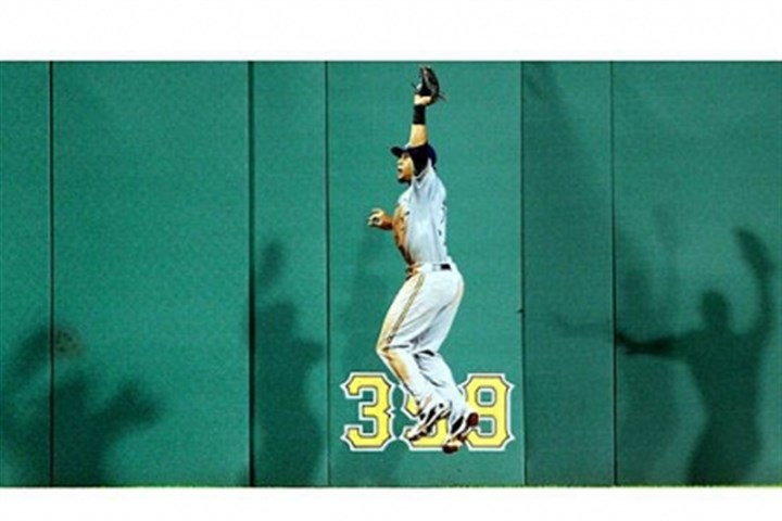 Sanchez denied Milwaukee's Carlos Gomez leaps to pull in a fly ball hit by the Pirates' Gaby Sanchez in the seventh inning Thursday night. The Pirates lost, 4-0