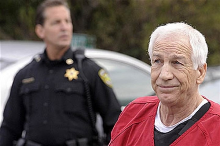 Sandusky 1 arrival court Former Penn State assistant football coach Jerry Sandusky, here being escorted into the Centre County Courthouse, is fighting to keep his state pension.