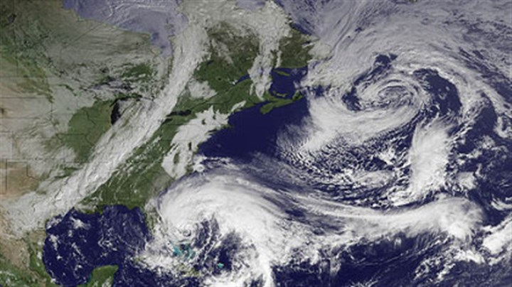 sandy latest frankenstorm In this image taken by NOAA today, Hurricane Sandy is seen in the center bottom.