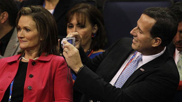 Santorum Former Pennsylvania Sen. Rick takes a picture on Tuesday of his wife Karen during the convention.
