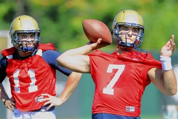 savage Pitt quarterback Tom Savage delivers the football as Trey Anderson watches during practice at the team's South Side facility.