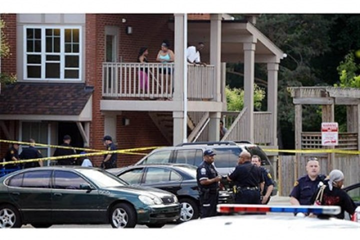 scene of a shooting Police investigate the scene of a shooting on East Hills Drive Tuesday.