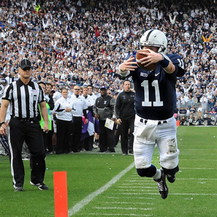 Scoring leap Penn State quarterback Matt McGloin leaps into the end zone scoring the game-winning touchdown against Northwestern in today's game at State College.