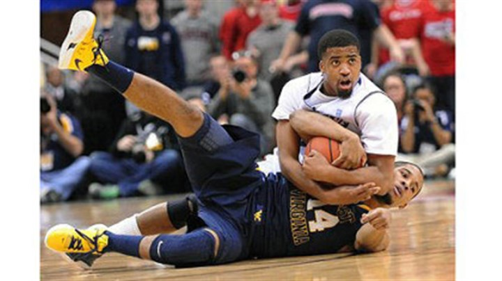 Sean Johnson Duquesne's Sean Johnson fights for possession with West Virginia's Gary Browne in the second half.