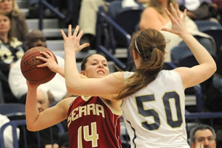 SerraVincentian Serra Catholic's Jessica Manfredi looks to pass around Vincentian's Brenna Wise.