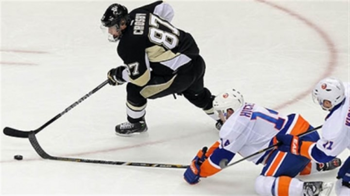 sid beats isles puck Sidney Crosby heads toward the net to score a goal against the New York Islanders in a May 9 game at Consol Energy Center.