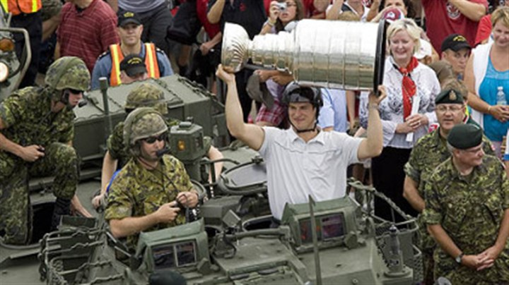 Sidney Crosby Penguins captain Sidney Crosby displays the Stanley Cup on an army light armoured vehicle after a flight on a Sea King helicopter, in Halifax, Nova Scotia yesterday.