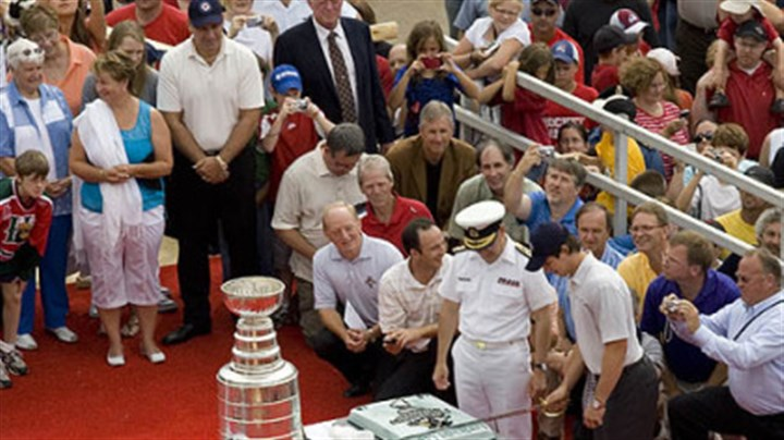 Sidney Crosby Penguins captain Sidney Crosby gets some help from Rear Admiral Paul Maddison as he cuts his cake marking his 22nd birthday in Halifax yesterday.
