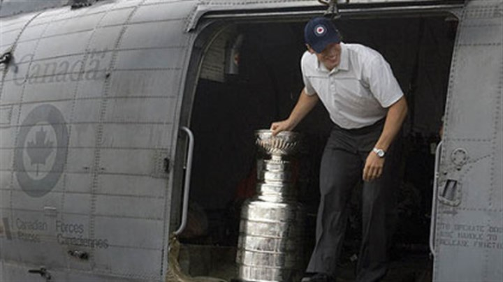 Sidney Crosby Penguins captain Sidney Crosby arrives with the Stanley Cup on the Canadian navy supply ship HMCS Preserver after a flight on a Sea King helicopter in Halifax, Nova Scotia yesterday.