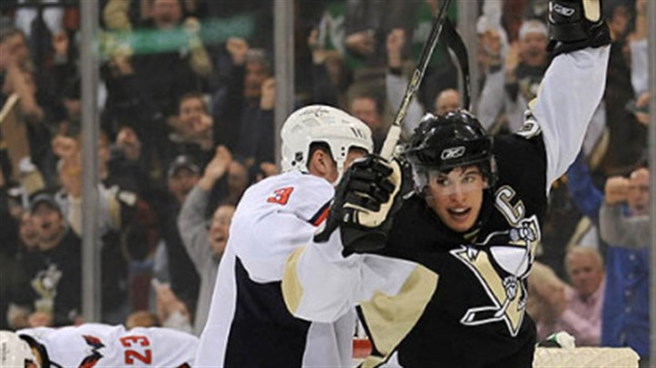 Sidney Crosby Sidney Crosby celebrates first period goal by teammate Colby Armstrong.
