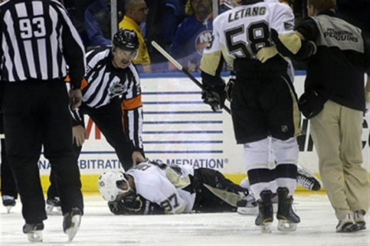 Sidney Crosby Penguins center Sidney Crosby lies on the ice after he was hit in the face in the second period against the Islanders.