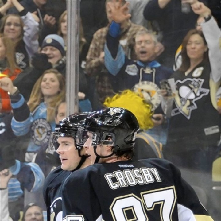 Sidney Crosby and Chris Kunitz Sidney Crosby congratulates Chris Kunitz after he scored in the first period against the Jets. Crosby had two assists in the 4-0 win as the Penguins stretched their winning streak to 14 in a row.
