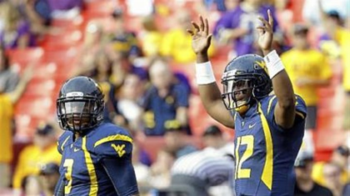 smith West Virginia quarterback Geno Smith, right, reacts after a touchdown pass to wide receiver Stedman Bailey in the first half Sept. 15 against James Madison in Landover, Md.