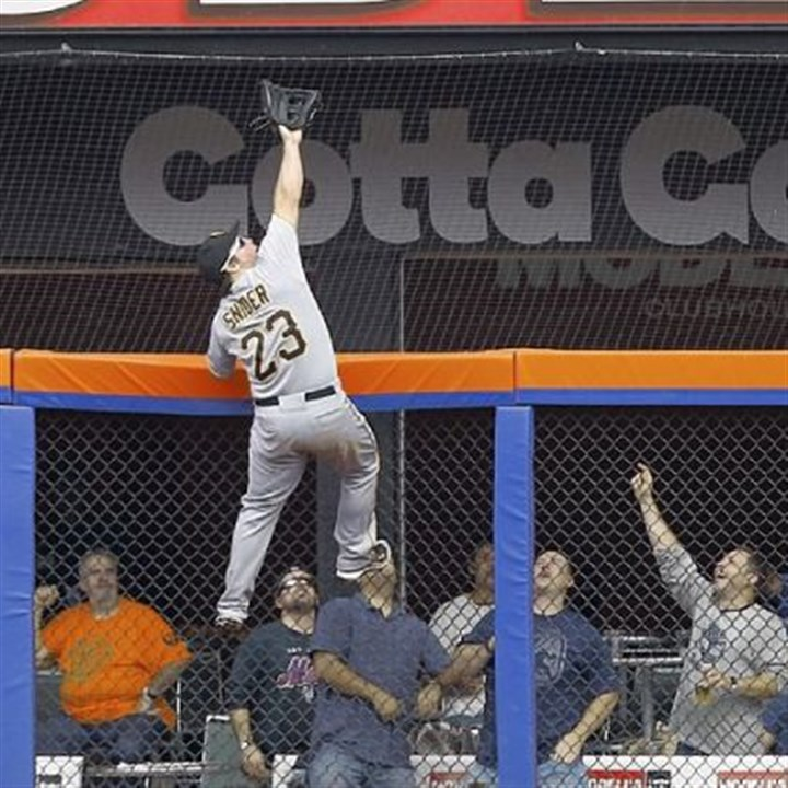 Snider Travis Snider climbs the fence to rob the Mets' Mike Baxter of a home run Thursday at Citi Field in New York.