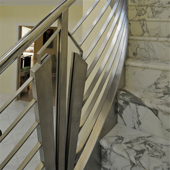 Staircase The decorative railing features custom glass and hand wrought polished stainless steel.