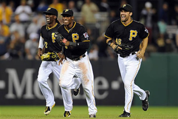 Starling Marte Pirates' Andrew McCutchen, Starling Marte and Garrett Jones come off the field after defeating the Brewers at PNC Park Friday night.