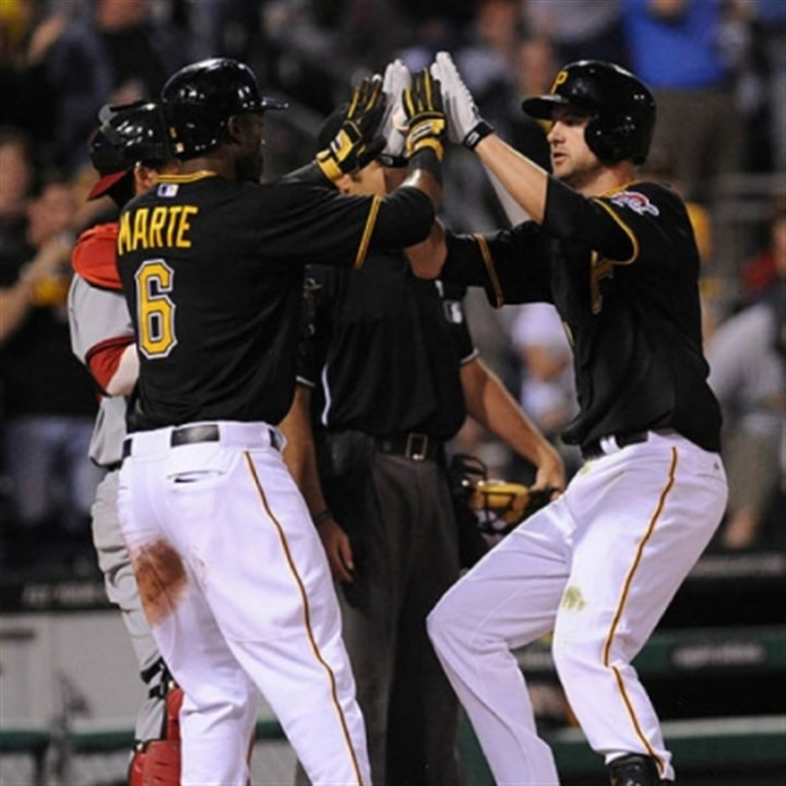Starling Marte The Pirates' Starling Marte, left, high-fives Jordy Mercer after his two-run homer against the Nationals.