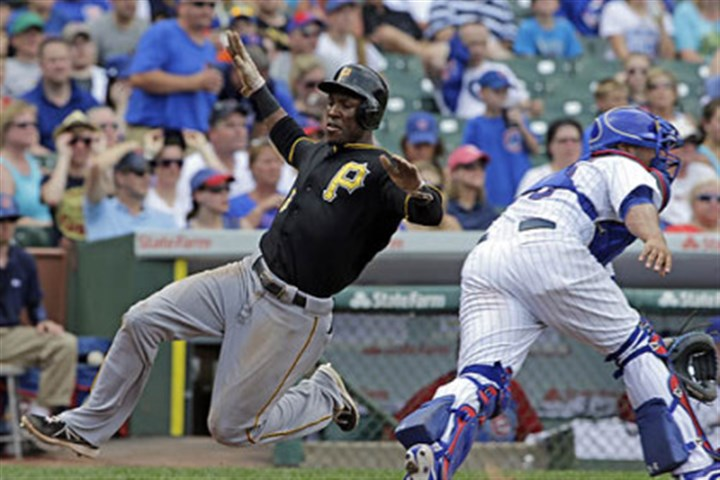 Starling Marte and Welington Castillo The Pirates' Starling Marte scores on a double hit by Jose Tabata as Chicago Cubs catcher Welington Castillo tries to catch the ball during the fifth inning.
