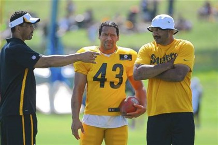 steel2 Former Steeler Rod Woodson, left, chats with Troy Polamalu and defensive backs coach Carnell Lake in practice Friday at Saint Vincent College in Latrobe. Rod Woodson is at training camp as a coaching intern.