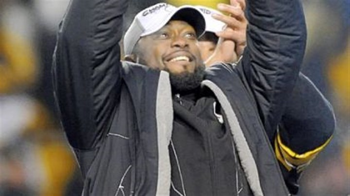Steelers coach Mike Tomlin Steelers coach Mike Tomlin hoists of the trophy after defeating the Jets at AFC Championship at Heinz Field Sunday.