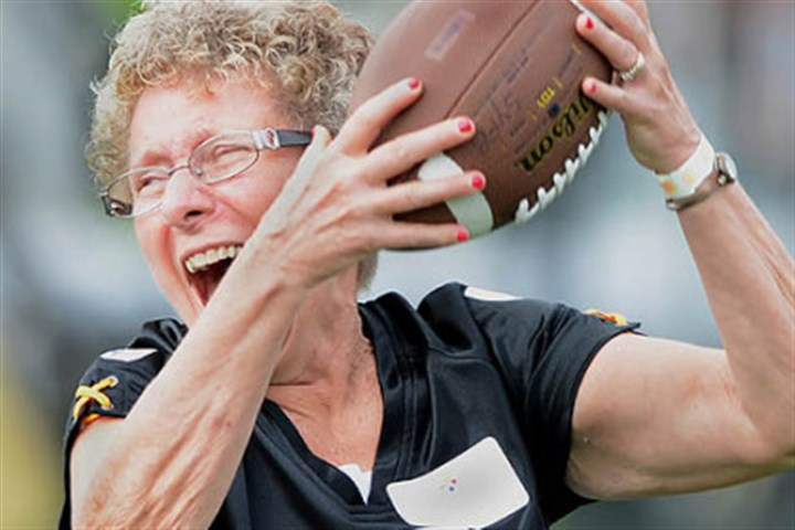 Steelers Women's Training Camp Judy Lucas celebrates after making a catch during the Steelers Women's Training Camp at Saint Vincent College presented by UPMC Magee-Womens Hospital.