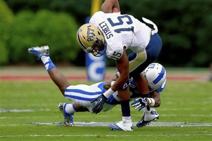 street Devin Street is tackled by Duke's Garett Patterson Saturday after making a reception.