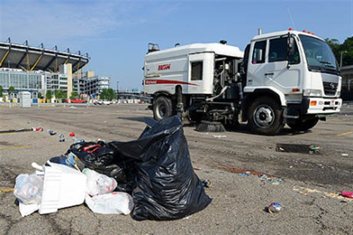 Street sweepers clean up after Chesney Street sweepers cruise the parking lots at Heinz Field to clean up the trash following Saturday night's Kenny Chesney concert.