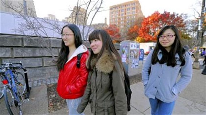 students International students Ellen Hu, 23, Maggie Lin, 23, and Lauren Su, 20, right, walk to class at the University of Pittsburgh.