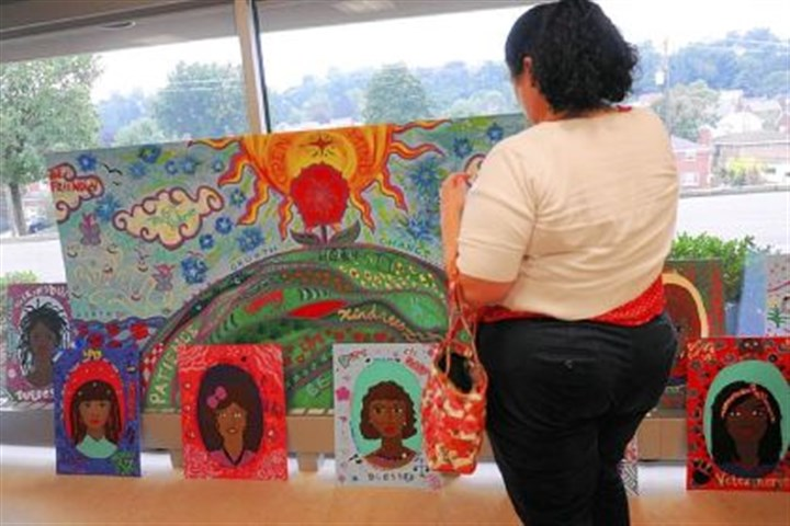 students who worked on the project The mural painted by the girls also includes self-portraits of the students who worked on the project.